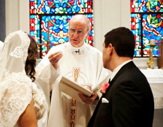 Priest officiating a wedding in church